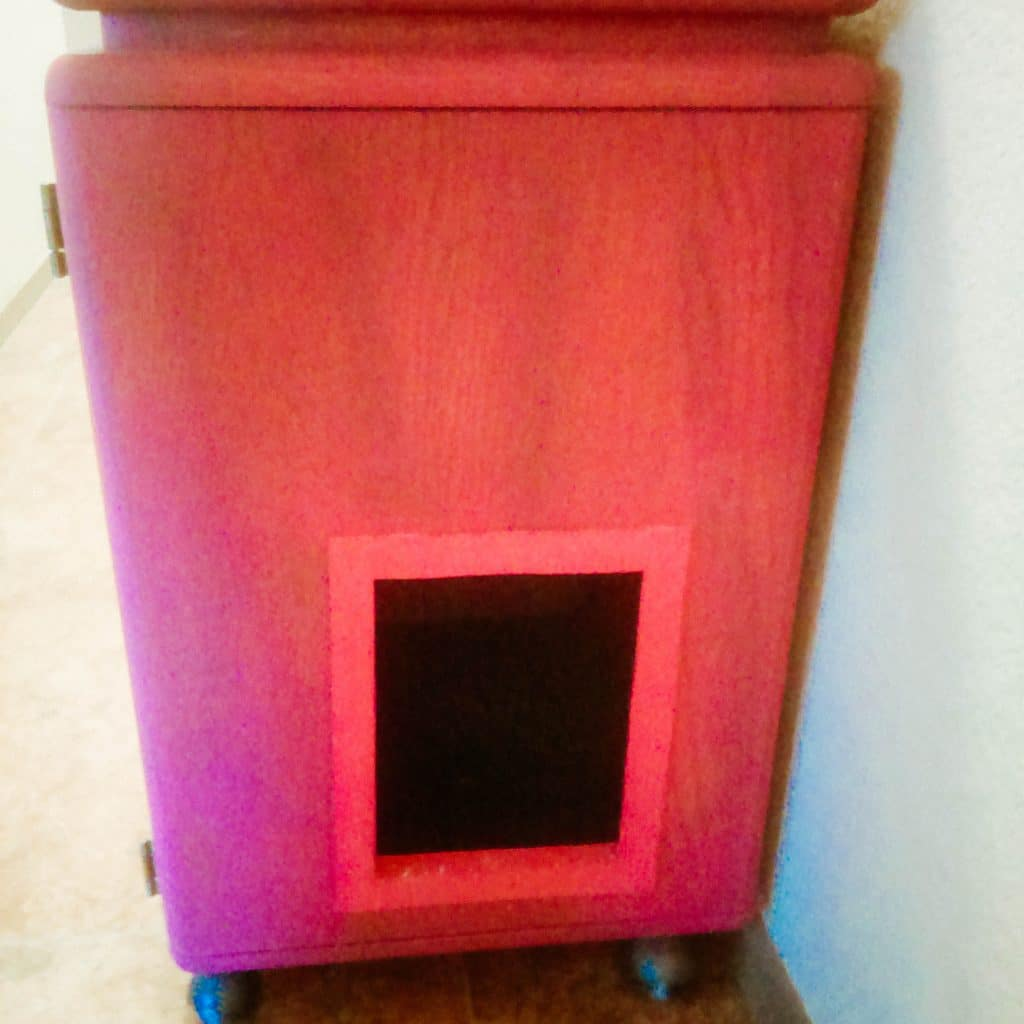 Cat litter cabinet kitty door.